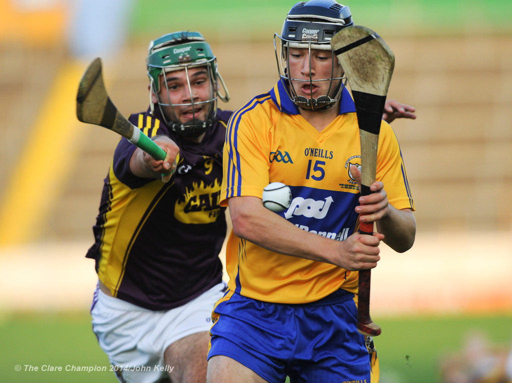 David Reidy of Clare in action against Conor Devitt of Wexford during the All-Ireland U-21 final in Semple Stadium, Thurles. Photograph by John Kelly.