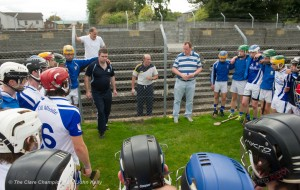 Kilmaley manager Niall Romer gives the team talk to his charges fro outside the wire before their Minor A county final at Cusack Park Photograph by John Kelly.