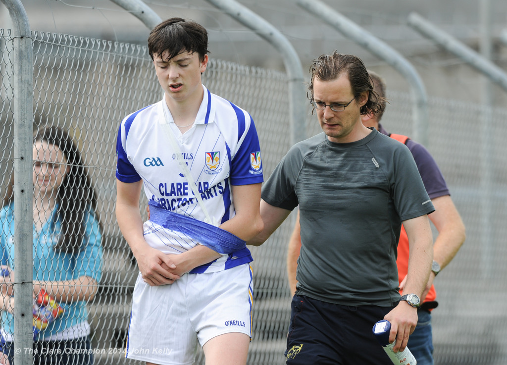 Colin Hehir of Kilmaley is escorted off with an injury by physio Keir Mc Namara during their Minor A county final at Cusack Park Photograph by John Kelly.