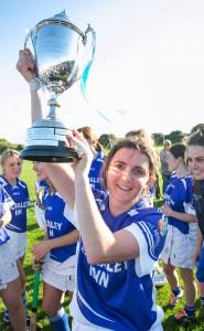 Kilmaley captain, Claire McMahon celebrates with the cup. Photograph by Arthur Ellis.
