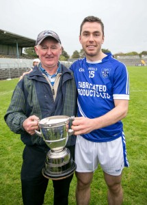 Cratloe manager Joe McGrath with his son Conor after victory over Crusheen in the County Final.Pic Arthur Ellis.