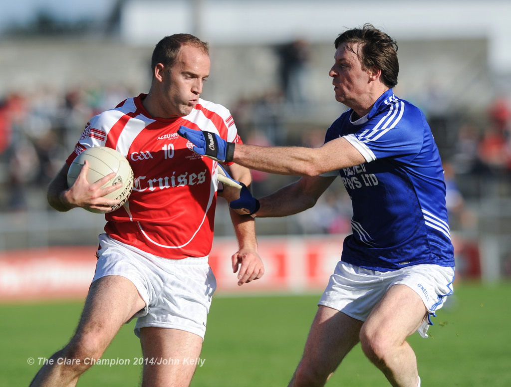 Stephen Hickey of Eire Og in action against Barry Duggan of Cratloe during their senior football final at Cusack park. Photograph by John Kelly.