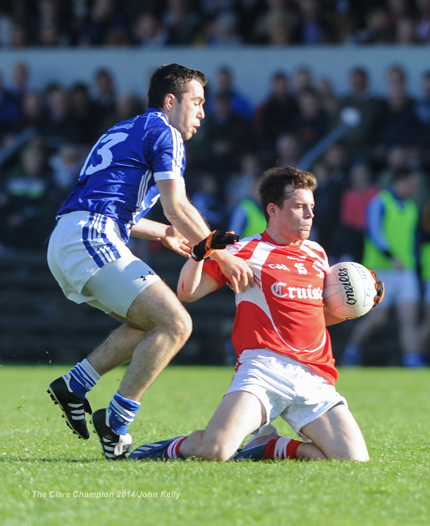 Conor Mc Grath of Cratloe in action against Eimhin Courtney of Eire Og during their senior football final at Cusack park. Photograph by John Kelly.