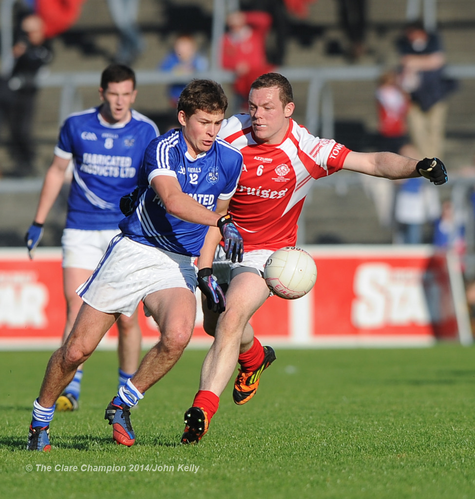 Liam Markham of Cratloe in action against Shane Daniels of Eire Og during their senior football final at Cusack park. Photograph by John Kelly.