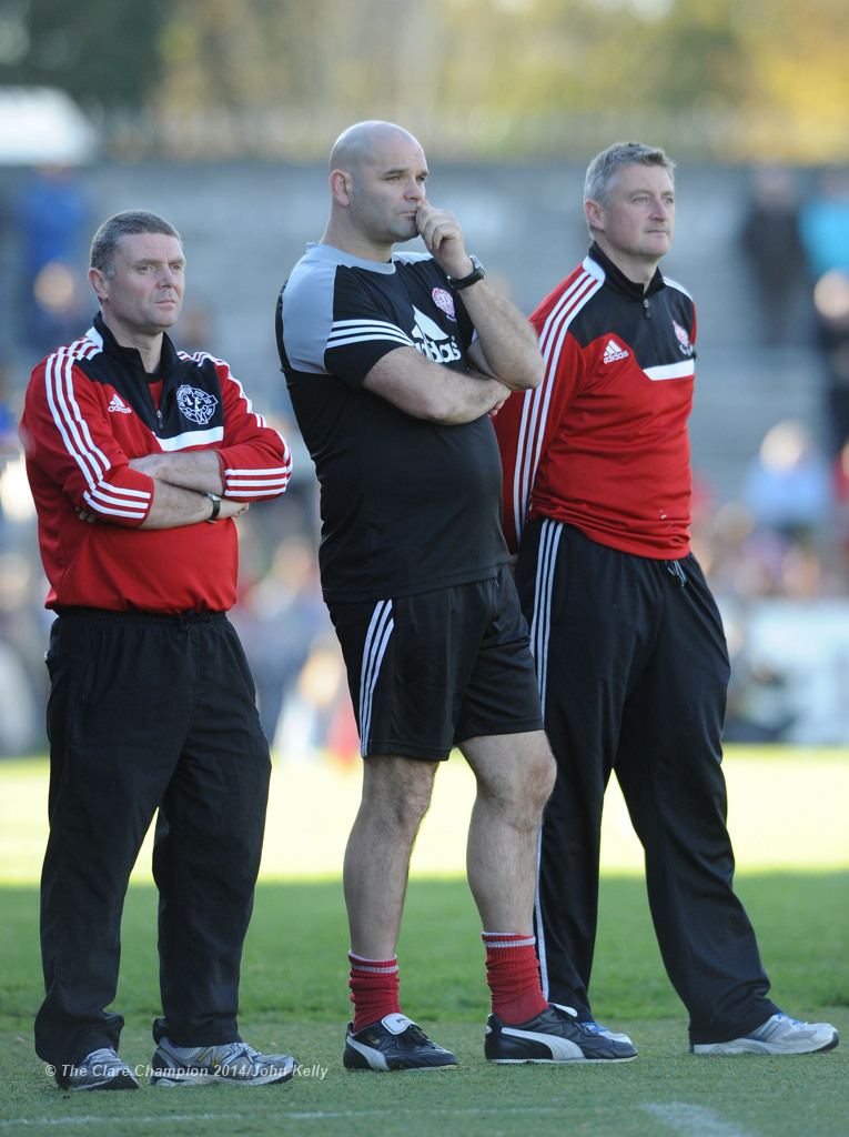 Eire Og manager James Hanrahan, right, and selectors Mattie Murphy and Cathal Shannon can only look on during the closing stages of their senior football final at Cusack park. Photograph by John Kelly.