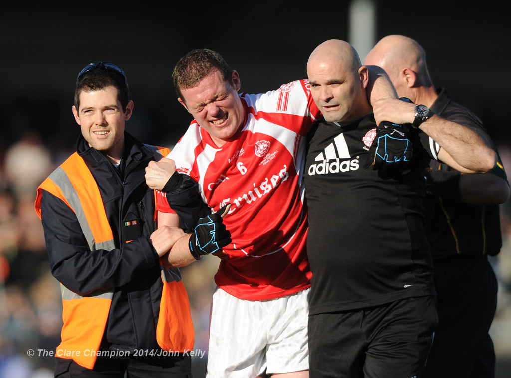 Shane Daniels of Eire Og is taken off injured near the end of their senior football final at Cusack park. Photograph by John Kelly.