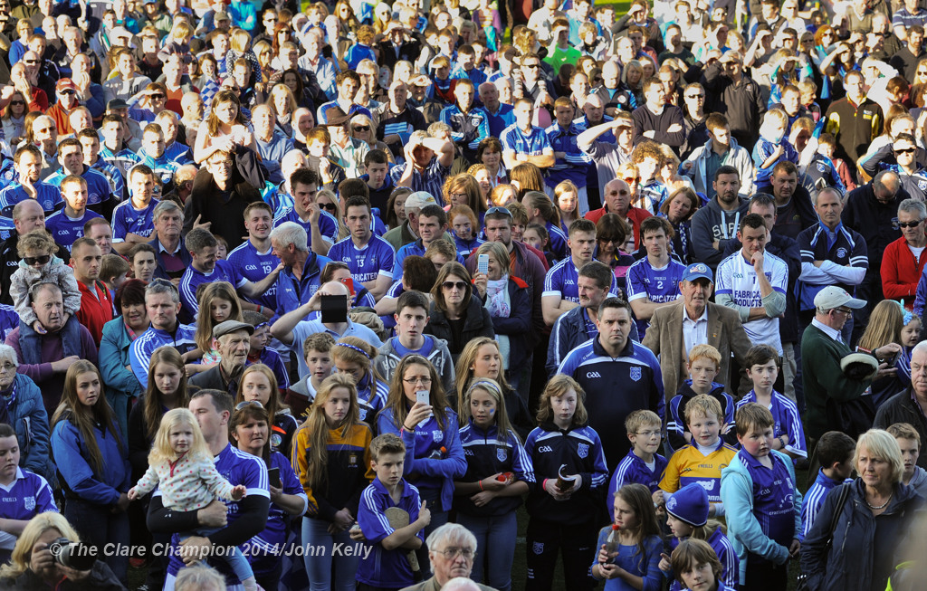 The Cratloe crowd look on as captain Micheal Hawes of  lifts the cup following their senior football final win over Eire Og at Cusack park. Photograph by John Kelly.