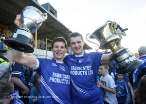 Hurling captain Liam Markham  and football captain Micheal Hawes with the two cups following their senior football final win over Eire Og at Cusack park. Photograph by John Kelly.