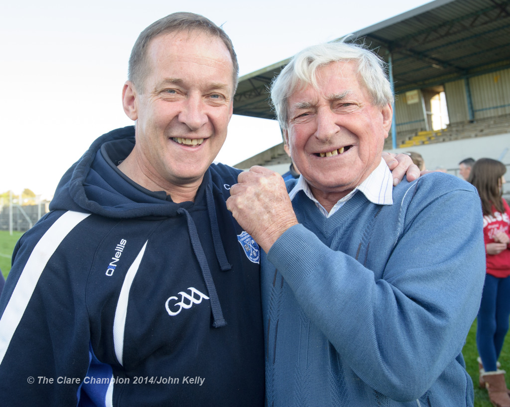 Cratloe manager Colm Collins is congratulated by his dad Cyril following the win over Eire Og in their senior football final at Cusack park. Photograph by John Kelly.