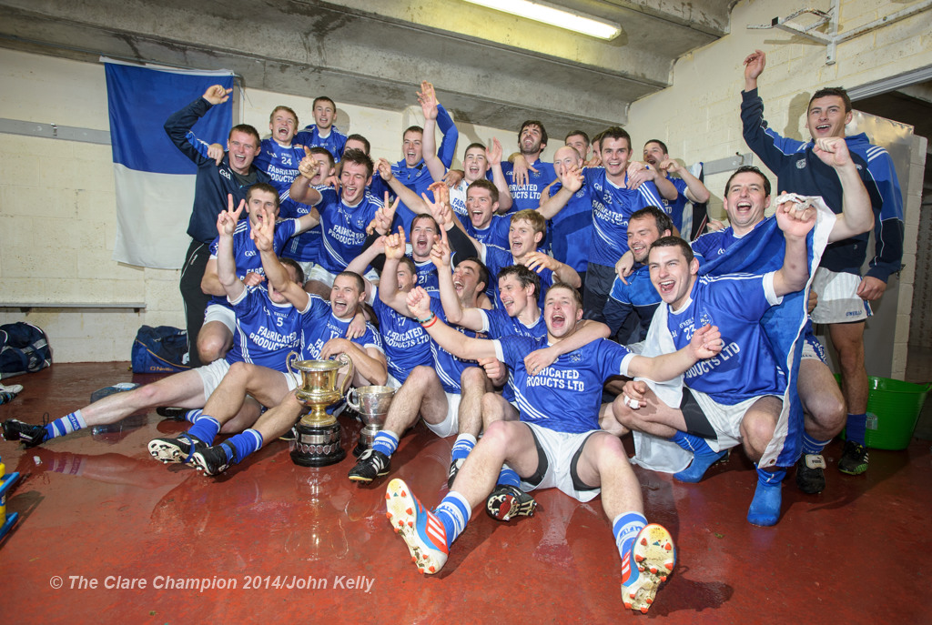 The Cratloe lads celebrate in the dressing room following their senior football final win over Eire Og at Cusack park. Photograph by John Kelly.