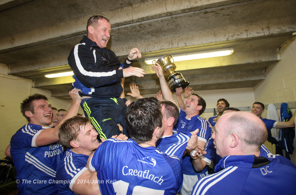 The Cratloe lads celebrate with manager Colm Collins  in the dressing room following their senior football final win over Eire Og at Cusack park. Photograph by John Kelly.