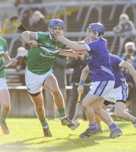 Philip O Loughlin of Kilmallock in action against Podge Collins of Cratloe during their Munster Club final at The Gaelic Grounds. Photograph by John Kelly.