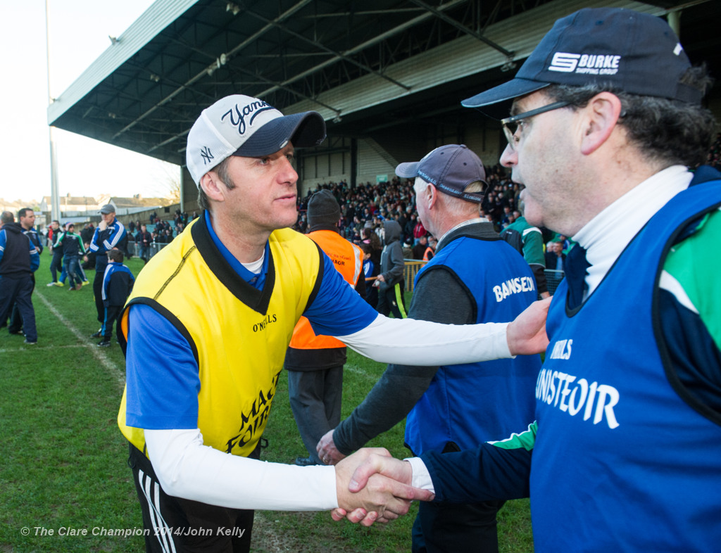Defeated Cratloe selector Alan Neville and victorious Kilmallock manager Ger Sparrow O Loughlin, both Clarecastle natives, meet following their Munster Club final at The Gaelic Grounds. Photograph by John Kelly.