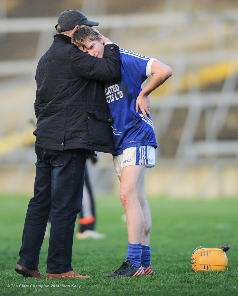 A disappointed David Collins of Cratloe is comforted by a supporter following the loss to Kilmallock in the Munster Club final at The Gaelic Grounds. Photograph by John Kelly.