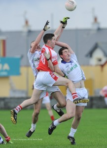 Liam Corry of Eire Og in action against Cian O Dea and Paul Carkill of Clann Lir during the  U-21A final in Miltown Malbay. Photograph by John Kelly.