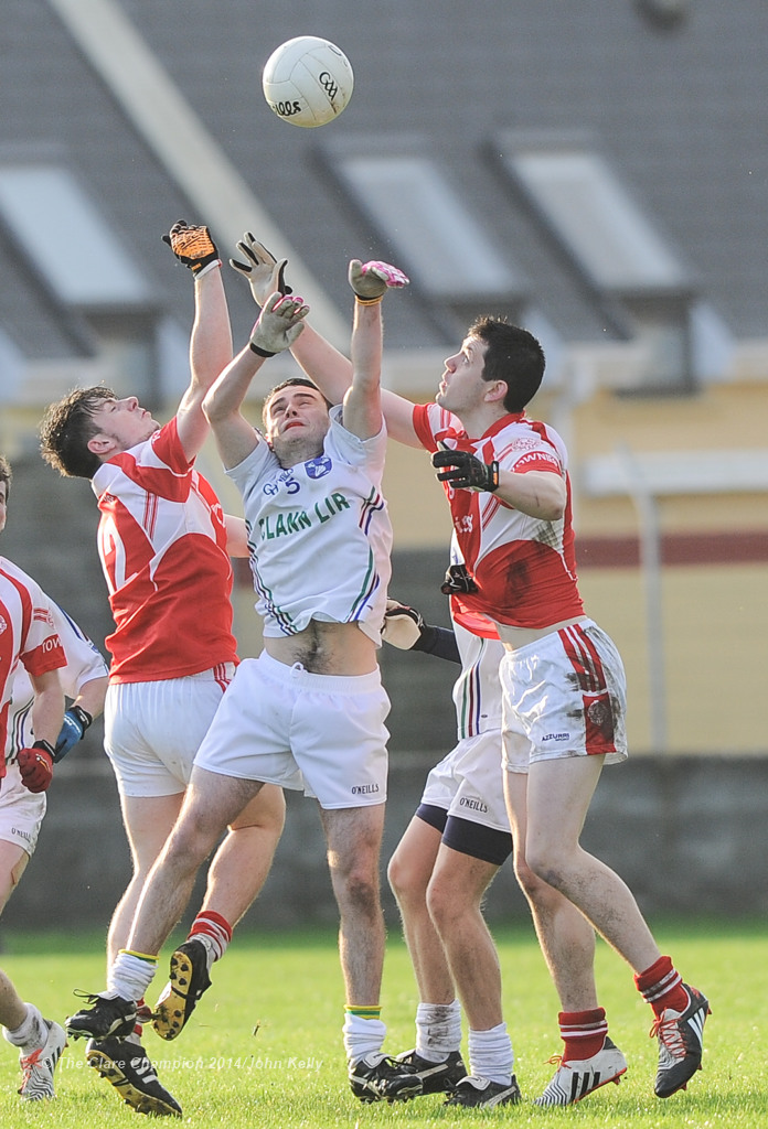 David Mc Namara of Clann Lir in action against Conor O Halloran and Cian Darcy of Eire Og during the  U-21A final in Miltown Malbay. Photograph by John Kelly.