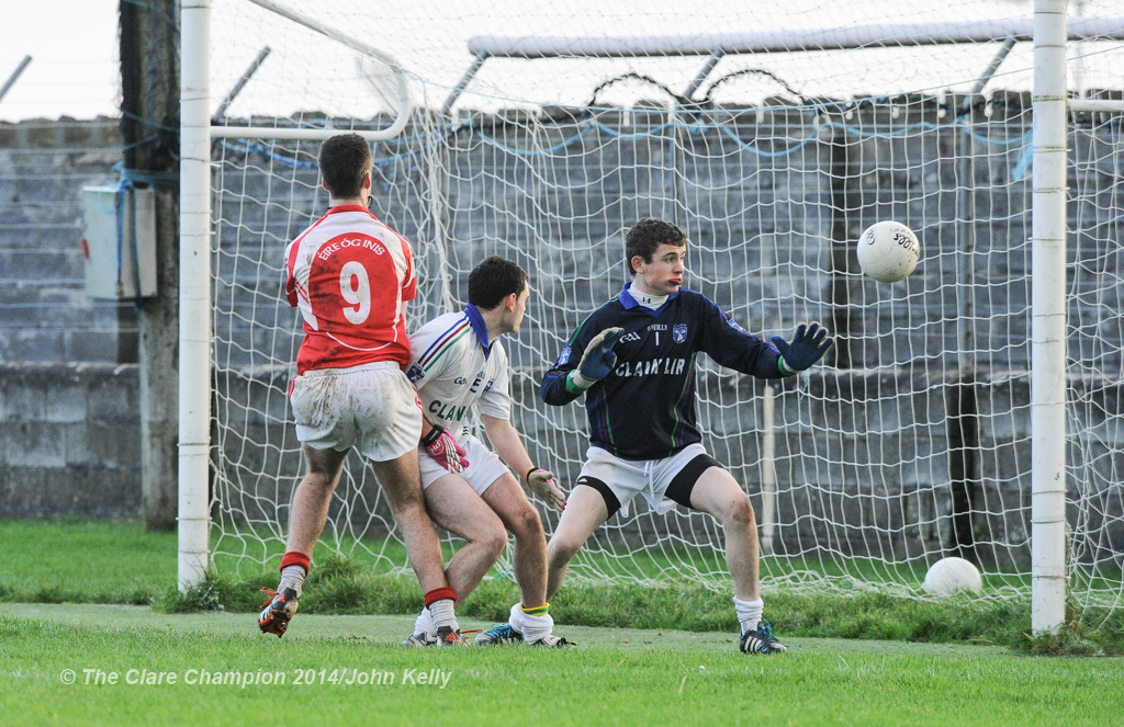 Dara Walsh of Eire Og scores a goal against David Mc Namara and John Fawl of Clann Lir during the  U-21A final in Miltown Malbay. Photograph by John Kelly.