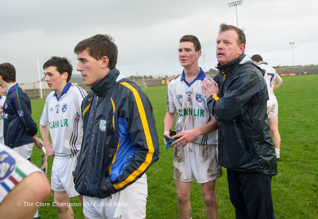 A clearly disappointed Darren Nagle of Clann Lir is comforted by Eire Og management member Donal O hAinifein following the  U-21A final in Miltown Malbay. Photograph by John Kelly.