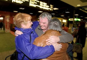 Shawn O Rourke is welcomed home for Christmas from England by his siblings, Deirdre and Brian O' Rourk. Photograph by John Kelly.
