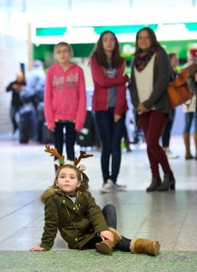 Young Keelan Kennedy from Adare patiently waits for her auntie Niamh Kennedy to arrive home for Christmas off the Heathrow flight. Photograph by John Kelly.