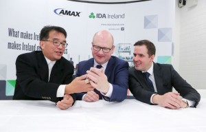 From left: Allen Lee, vice president of operations, AMEX showing a picture of hid granddaughter to Minister for Business & Employment, Ged Nash and Martin Shanahan, CEO IDA at the official opening of AMEX. Photograph by Brian Gavin Press 22
