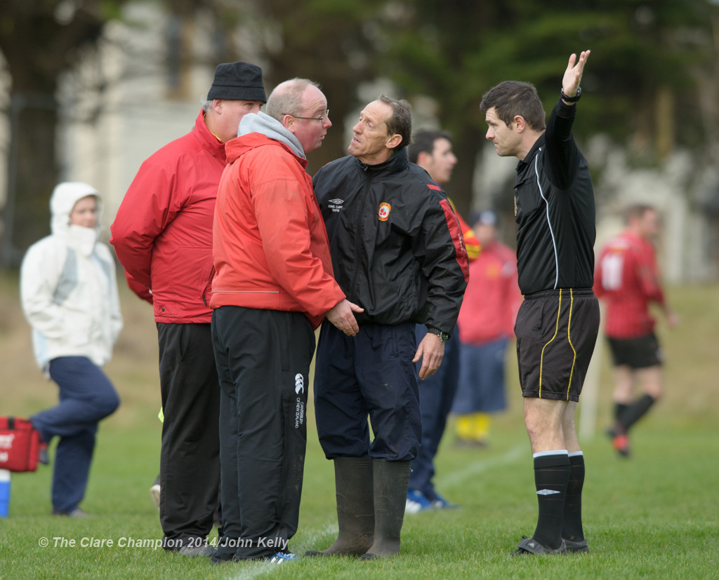 Pat Mc Daid, manager of Avenue United A  is sent away by referee James Ferns during their Premier League game against Bridge United A at Roslevan. Also in the picture is Avenue's Noel Purtill. Photograph by John Kelly.