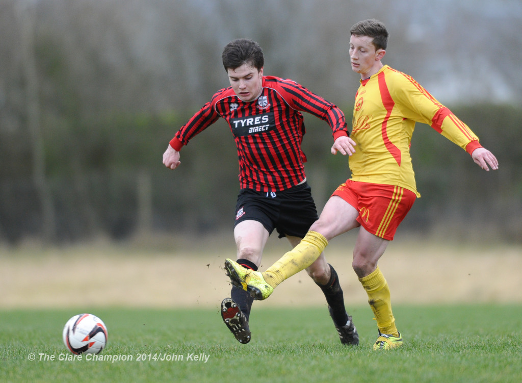 Darragh Fitzgerald of Bridge United A in action against Mark Roche of Avenue United A during their Premier League game at Roslevan. Photograph by John Kelly.