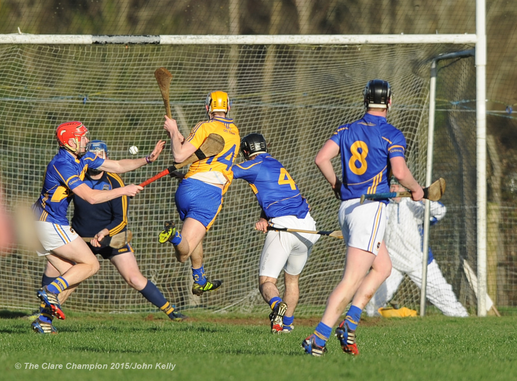 Aaron Cunningham of Clare is denied a goal chance by the Tipperary defence during their Waterford Crystal Cup game at Sixmilebridge. Photograph by John Kelly.