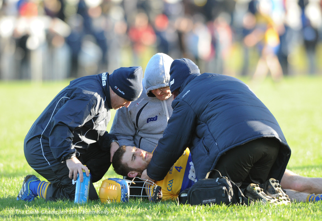 Seadna Morey of Clare is treated for an injury during their Waterford Crystal Cup game at Sixmilebridge. Photograph by John Kelly.