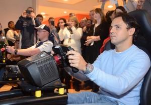 Felipe Massa takes on a Genworth employee in a race on an F1 simulator. Photo John Galvin.