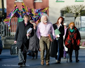 T.D's Mick Wallace and Claire Daly arriving with supporters at Ennis courthouse on Tuesday morning. Photograph by John Kelly.