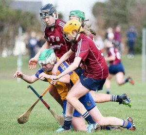 St Flannan's Zoe McInerney feels the pressure from Seamount's Niamh Murphy and Ciara Murphy in Gort on Saturday. Photograph by Arthur Ellis.