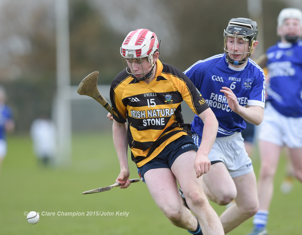 Gavin O' Brien of Crusheen-Tubber in action against Shane O' Leary of Cratloe during their U-21 semi final at Clarecastle. Photograph by John Kelly.
