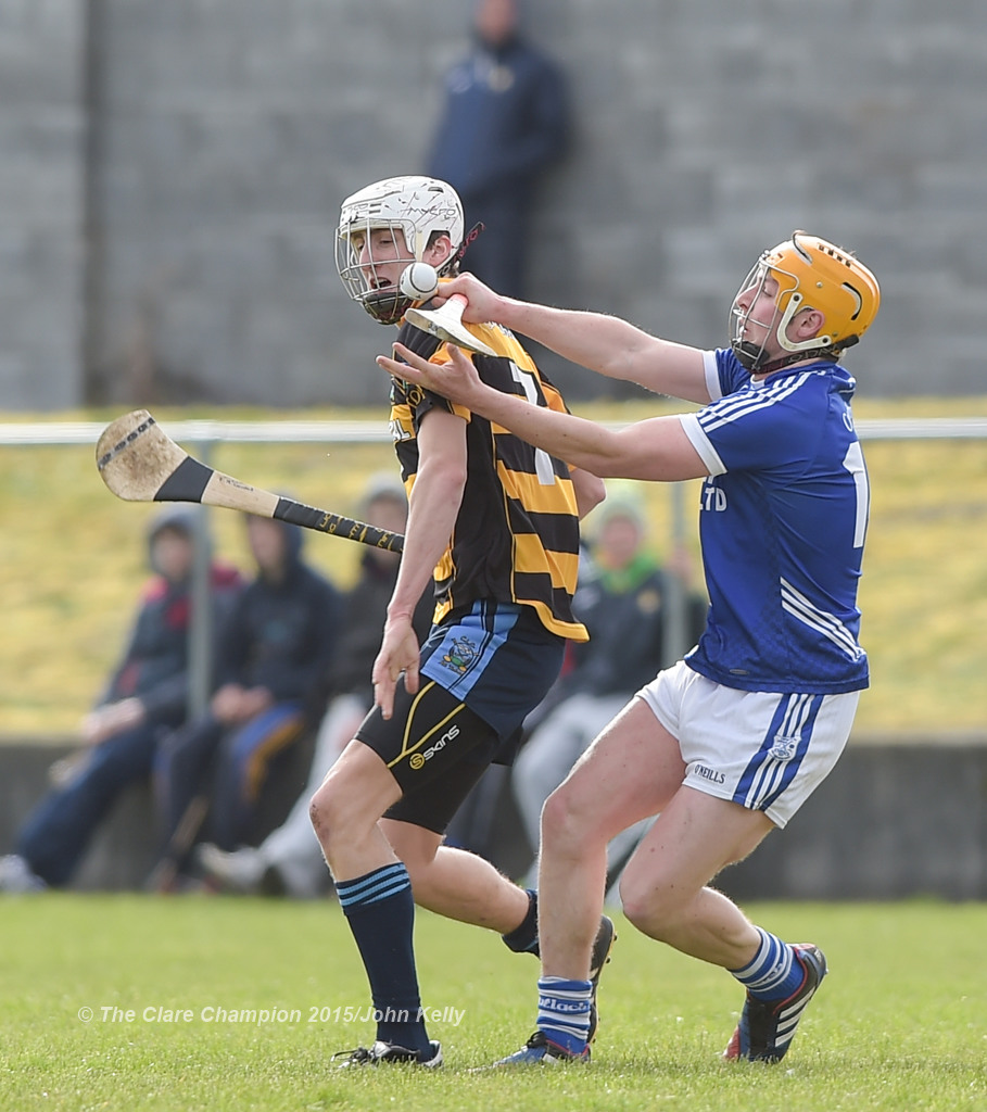 Francis McCormack of Crusheen-Tubber  in action against Shane Gleeson of Cratloe  during their U-21 semi final at Clarecastle. Photograph by John Kelly.