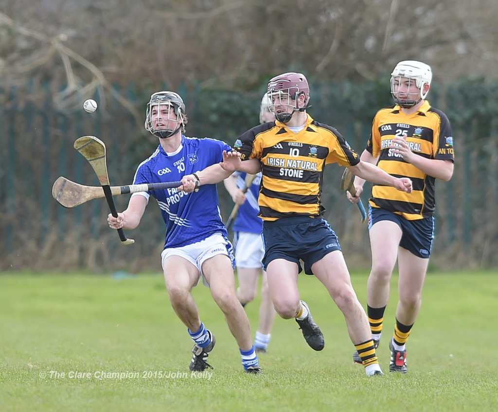 Michael Danaher of Cratloe  in action against James Howard of Crusheen-Tubber during their U-21 semi final at Clarecastle. Photograph by John Kelly.