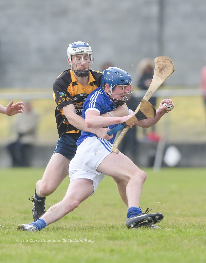Youen Horner of Crusheen-Tubber  in action against Conor Crosby of Cratloe  during their U-21 semi final at Clarecastle. Photograph by John Kelly.