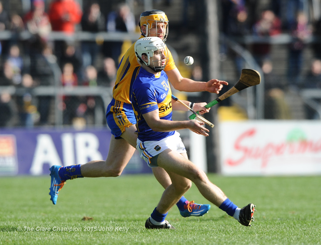 Niall O Meara of Tipperary in action against John Conlon of Clare during their game in Cusack park. Photograph by John Kelly.
