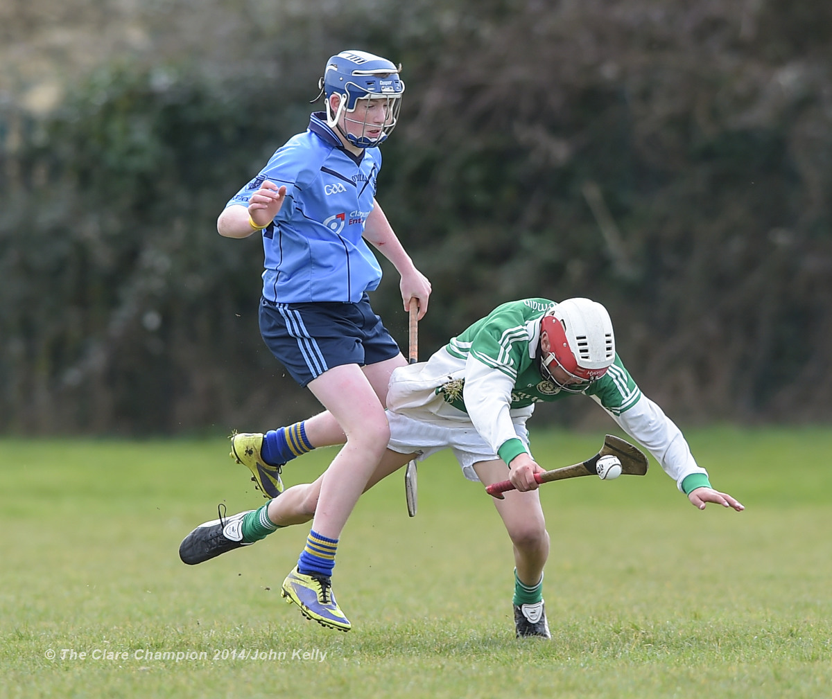 Martin Walsh of Scariff Community College  in action against Eoin Fitzgerald of Ennistymon CBS during their Munster U-15 D final at Clarecastle. Photograph by John Kelly.