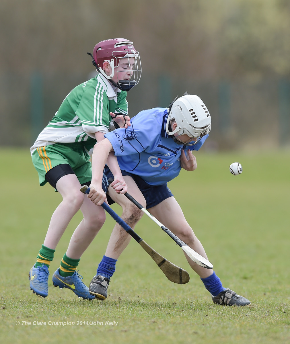 Dean Lynch of Ennistymon CBS in action against Shane Quinn Tuite of Scariff Community College during their Munster U-15 D final at Clarecastle. Photograph by John Kelly.