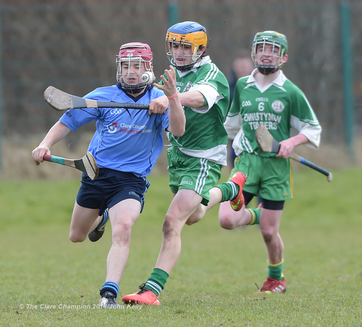 Conor Downes of Scariff Community College  in action against Aidan Mc Carthy of Ennistymon CBS during their Munster U-15 D final at Clarecastle. Photograph by John Kelly.