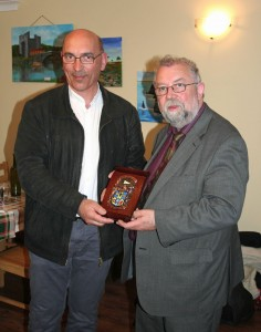 Cathaoirleach of Clare County Council, Councillor John Crowe, right, presents Mayor Yves Dauvé with the County Clare coat of arms.