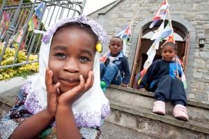 Yasmin from Togo, Enock from Burundi and Kadiata  from Guinea enjoying Africa Day. Photograph  by John Kelly