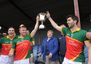 Broadford Smith O Brien's Mikey O Shea and Sean Phelan lift the cup following their win over Wolfe Tones in the Minor A Hurling final in Sixmilebridge. Photograph by John Kelly.