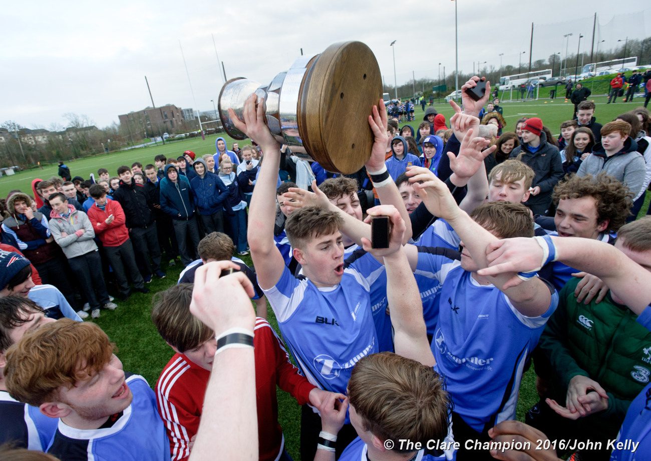 Player Alex Blake and St Caimins team mates celebrate with the cup following their win over Abbey CBS.