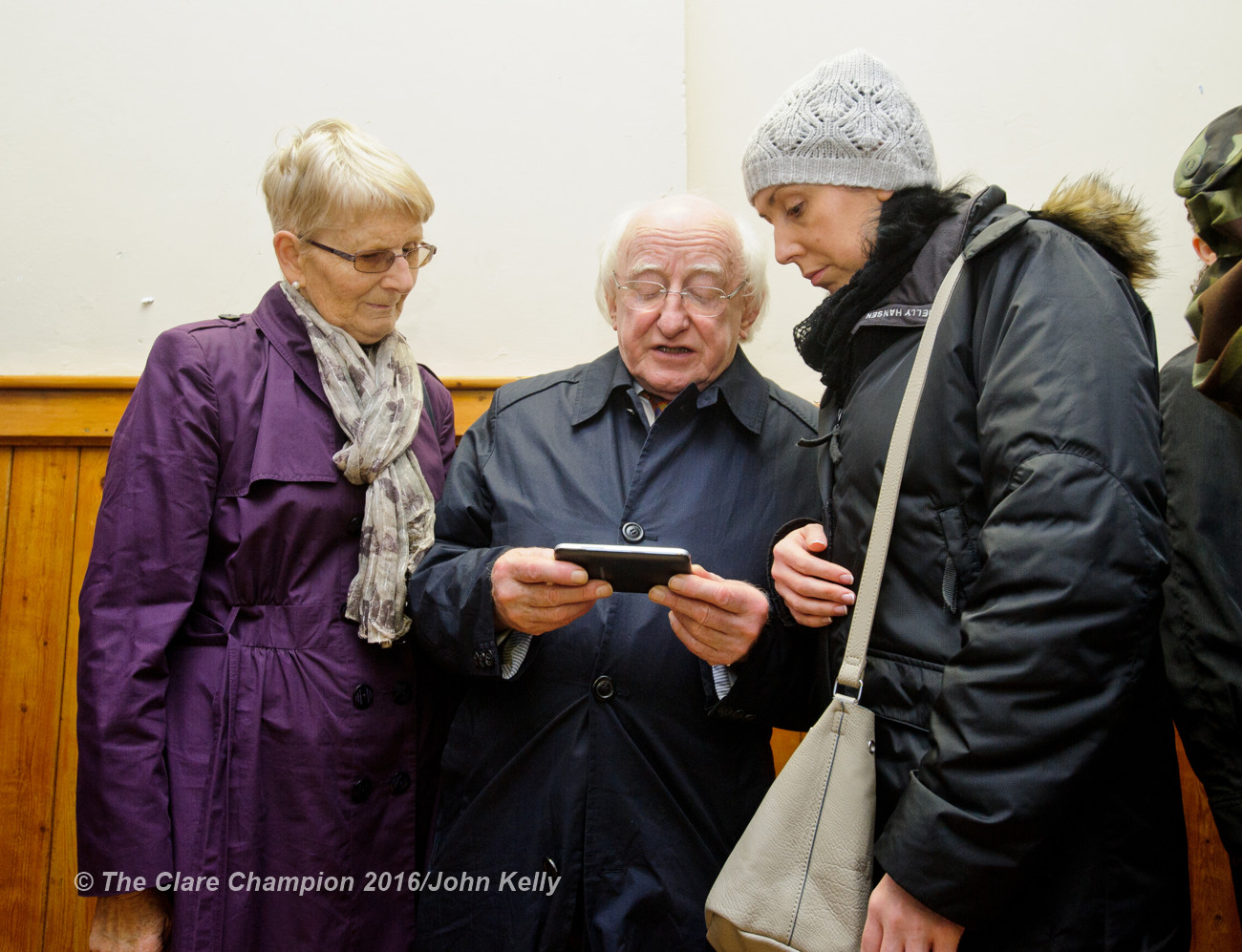President Michael D Higgins chatting with Sarah Burke and her mother-in-law Sheila Burke of Cahermore, Kinvarra, who have houses affected by flooding during his visit to Labane to meet the victims of flooding in the area. Photograph by John Kelly.