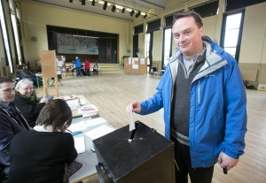 Fr Ger Fitzgerald casting his vote at The Holy Family National School. Photograph by Arthur Ellis.