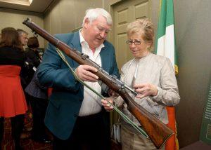 Pat Kirby and Nora O'Brien, daughter of volunteer John O'Brien, looking at an old gun. Photograph by John Kelly.