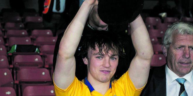 Captain Shane McGrath lifts the cup.