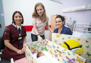 Dr Naro, Jennifer Clary, CEO Baby Box, and Lisa Healy with her newborn daughter, Leah in the box Photogaph by Arthur Ellis