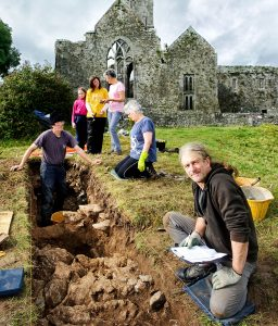 Archaeologist Graham Hull recording information uncovered on an archaeological dig in the shadow of Quin Abbey. In the background are volunteers Ritchie Jones, Ita Lawton, Fiona Clancy with her daughter Lilian, and Mary Howard. Photograph by John Kelly.